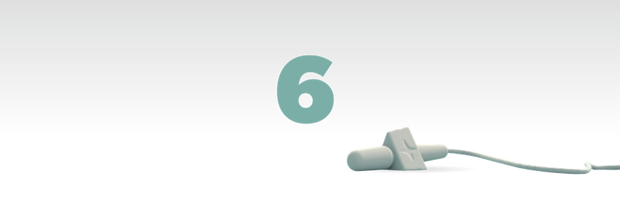 Illustration of the number six in green with a mic laying in front of it