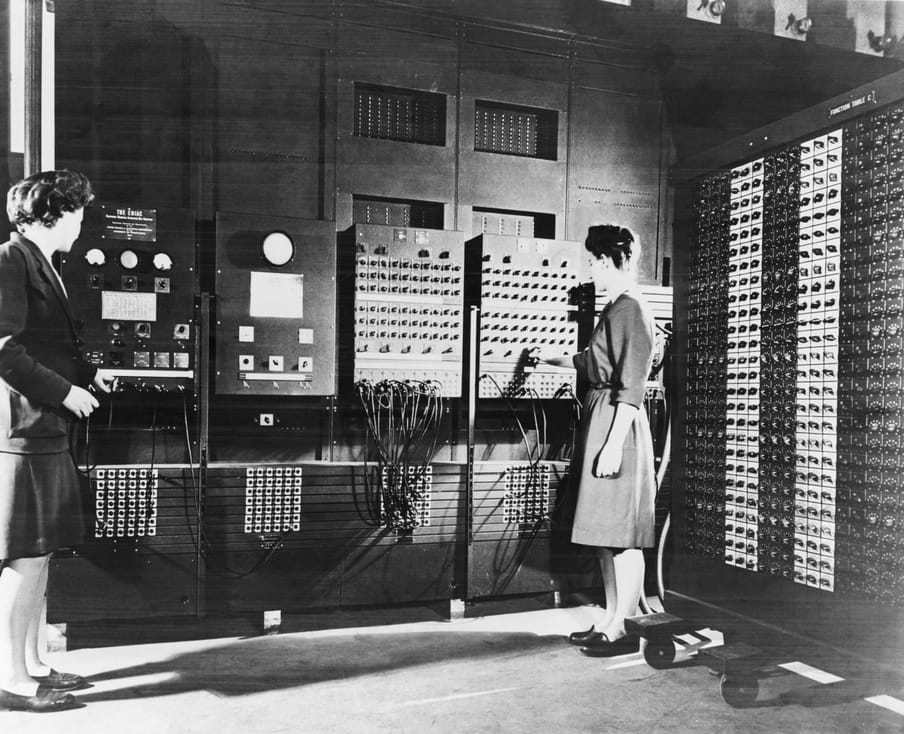 Black and white photograph standing next to electronic boards.