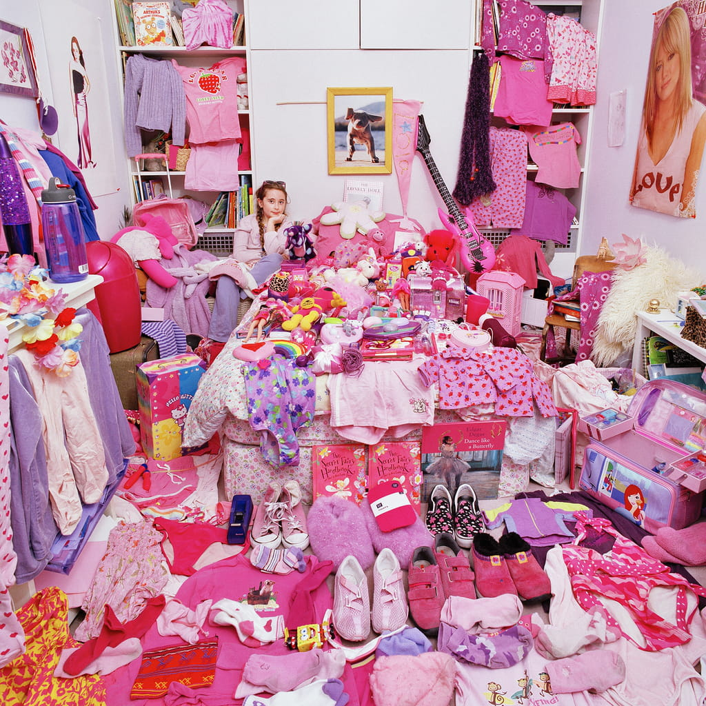 Photo of a girl surrounded by pink items