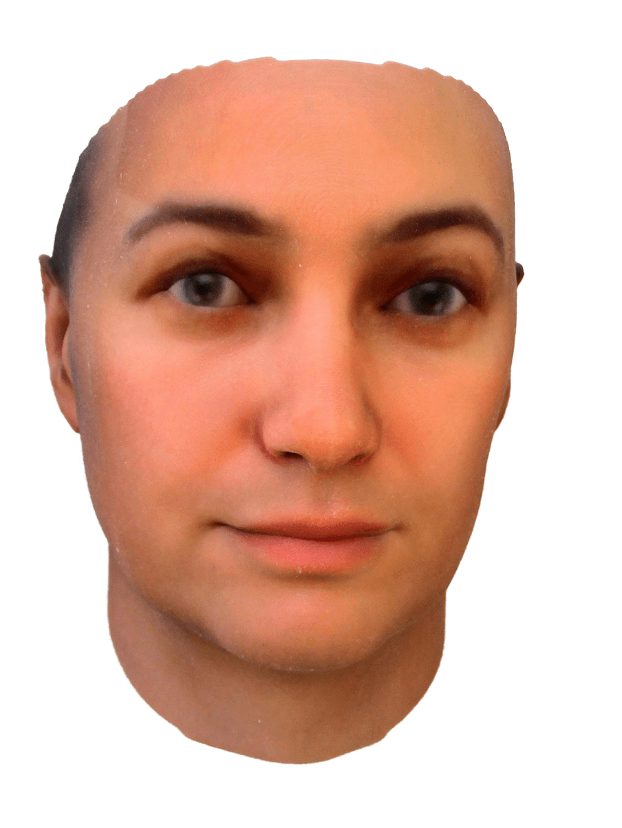 Photo of a 3D printed face of a woman with white skin and brown eye colour on the left - against a white background