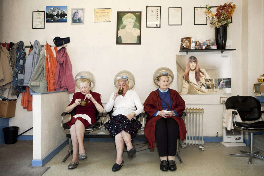 Photo of three older women at the hairdresser