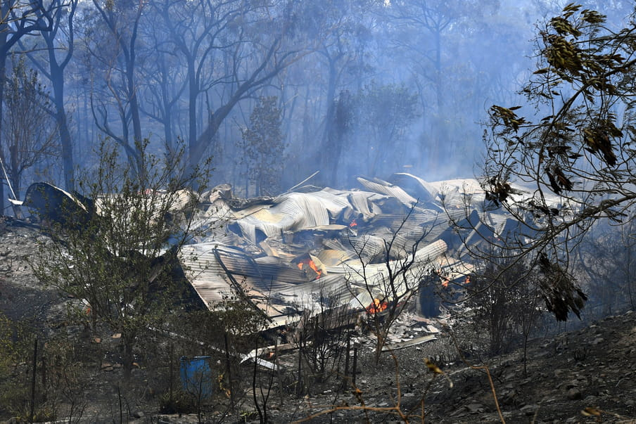 A destroyed home is seen after a bushfire past through, in Buxton, New South Wales, Australia, 19 December 2019. Temperatures above 40 degrees Celsius and strong winds are fanning a number of fires around Sydney.