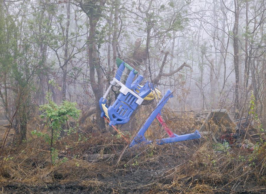 Photo of a swing set fallen over