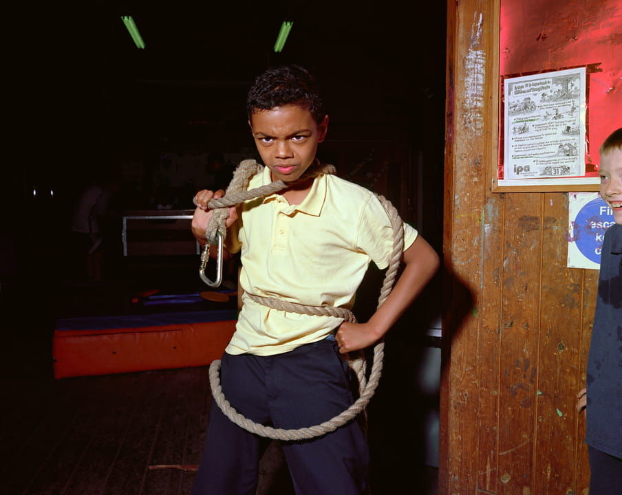 Photo of a kid at the center playing with a rope.