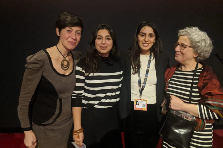 This is a picture of four women standing next to each other, with the correspondent Irene Caselli to the left.