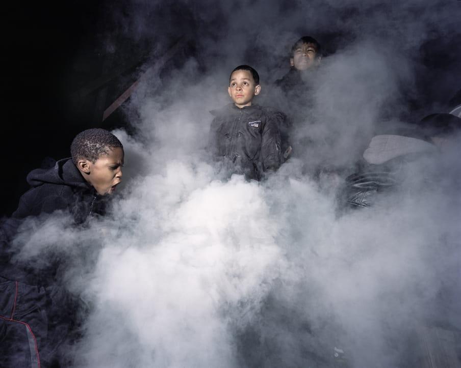 Photo of three kids playing with smoke
