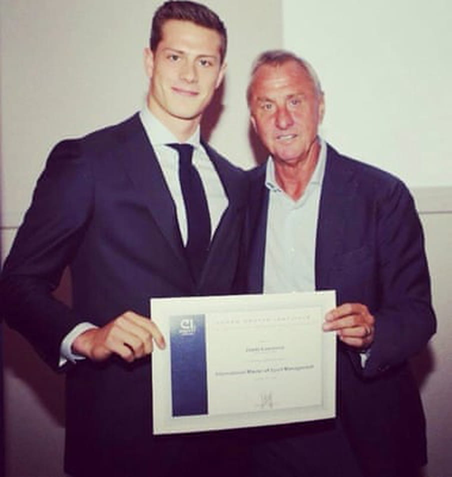 Polaroid style photo of Steve Lawrence (on the left) receiving his diploma from the Dutch football legend Johan Cruijf (on the right).