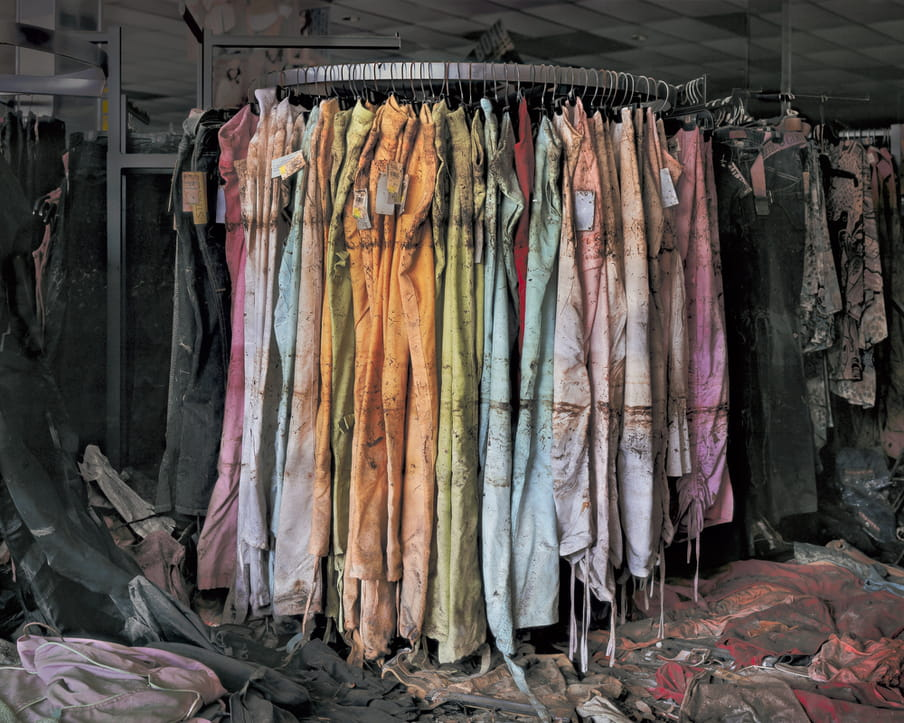 Photo of a rack of pants, destroyed by water damage