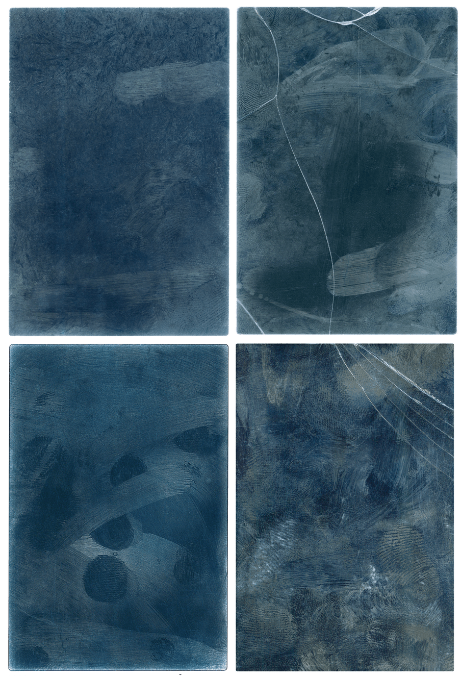 Rectangles of blue side by side in a 2:2 formation. They are dark blue with lighter whiter smudges on them; to the right both images have glass cracks running through them