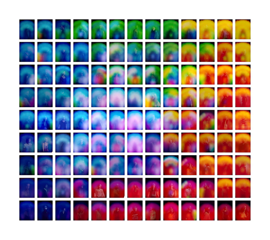 Grid of portraits, all people are covered with slightly different color glows.