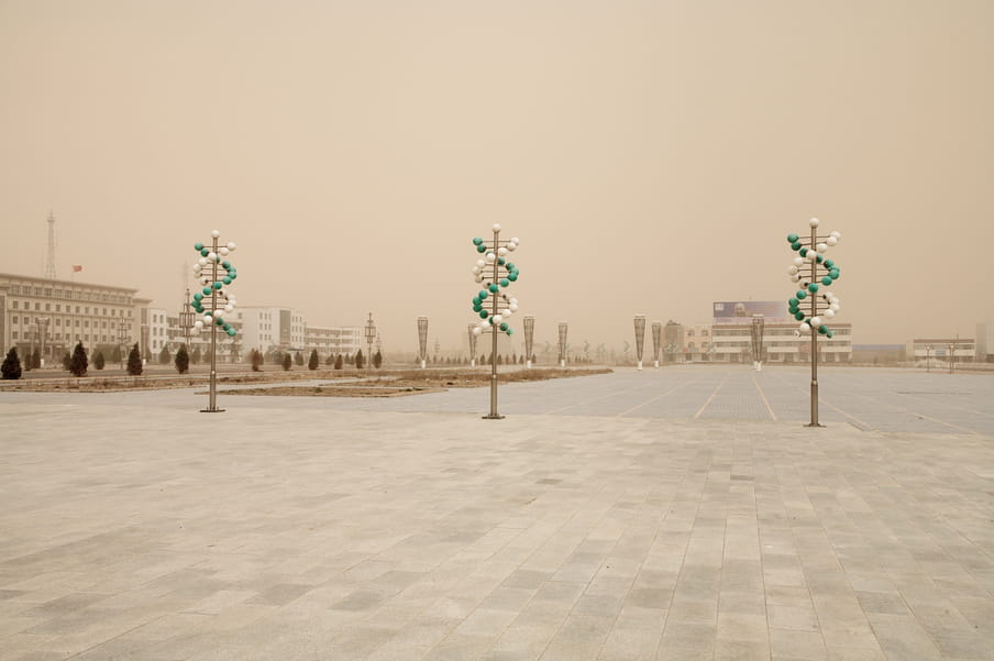 View of an empty public space. The image as a yellow tint.