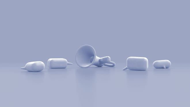 3D animation of a loudspeaker - made of either white foam or concrete to the eye - lying on the floor, with two 3D speech bubbles both lying and standing on the floor on either side of it. The filter of the image is a light lilac, the objects a faded white
