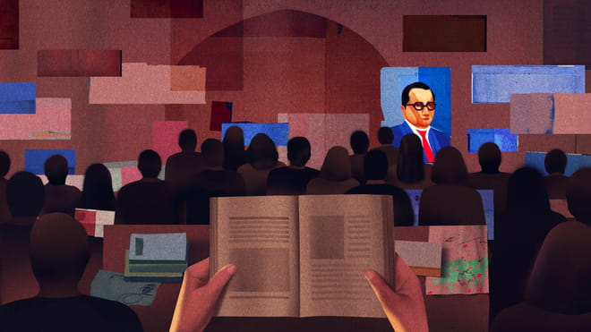 Illustration with in the front and center two hands holding a book, with behind it people sitting together looking at a stage. On the stage a poster is hanging on the wall of a man with glasses in a blue suit.