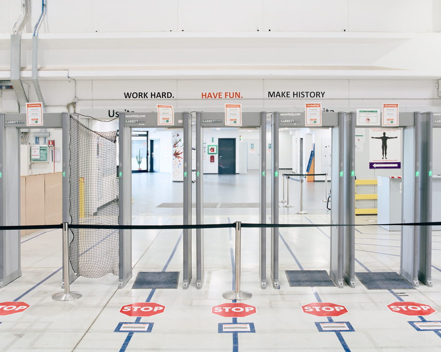 Colour photograph of an entrance with security devices.