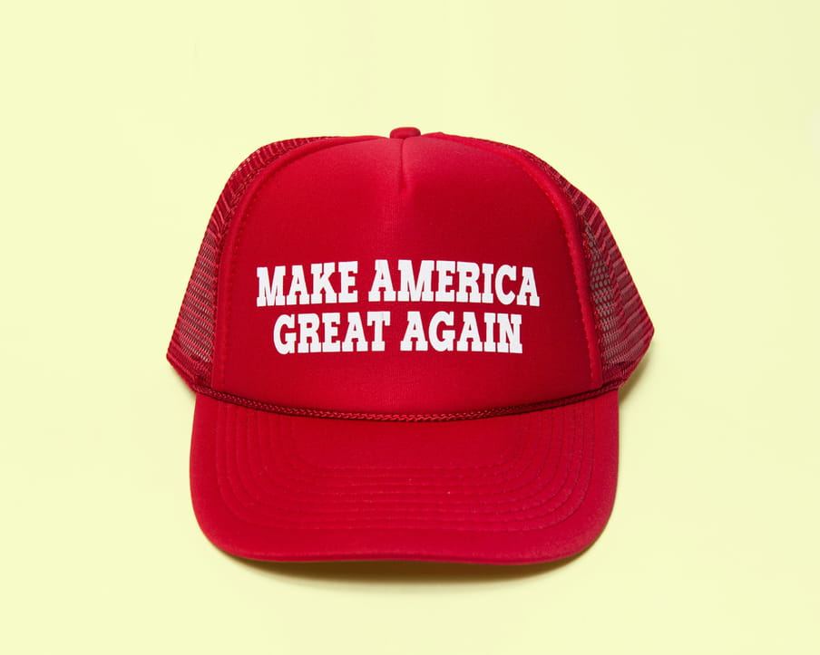 Photo of a red cap with the text 'Make America Great Again'
