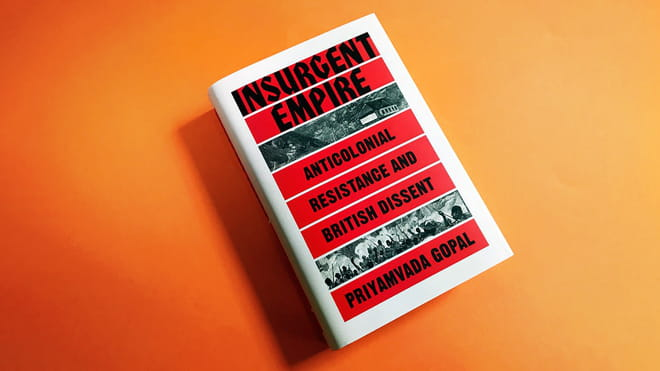 Photograph of a book laying on an orange background. The cover is white, with red stripes where the following text appears in black: Insurgent Empire, anticolonial resistance and British dissent, Priyamvada Gopal. Two stripes show black and white engraving, one of a house, the other one of a group of people with weapons.