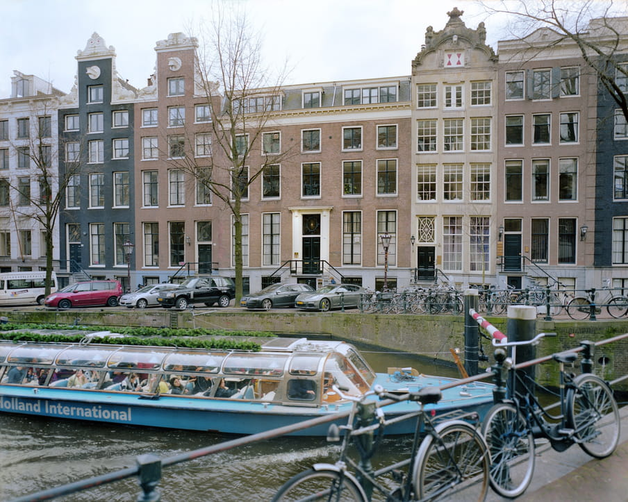 Picture of a canal with a tourist boat
