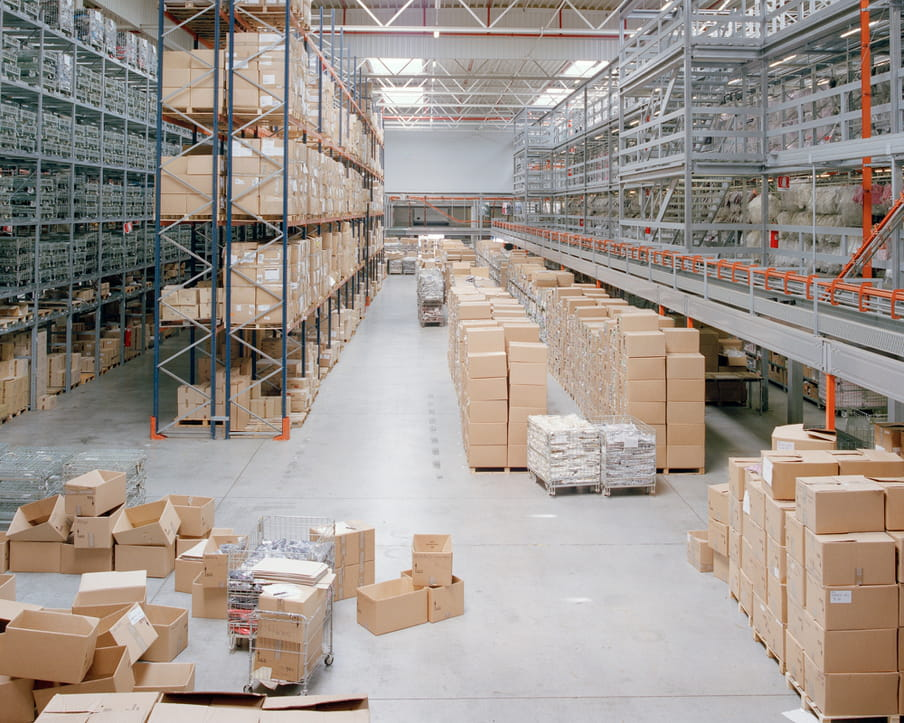 Colour photograph of a warehouse showing shelves and boxes.