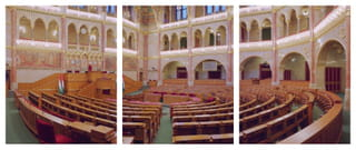 Photograph of a large hall with many chairs