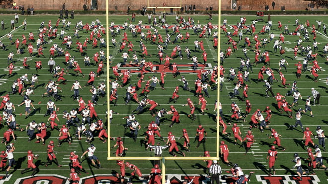 Photo-montage of an American football field, heavily crowded.