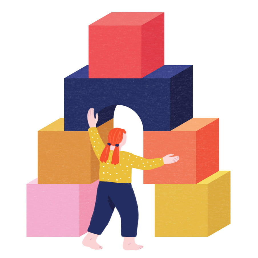 Illustration of the back of a barefoot, red-headed child with two ponytails at the back, wearing a mustard coloured top with white polka dots and blue trousers, playing with giant pink, orange, blue red and mustard coloured blocks, shaped as an arch. Her arms are outstretched at the top of the doorway made by the blocks, and to the right hand side. It looks like she might be passing through.