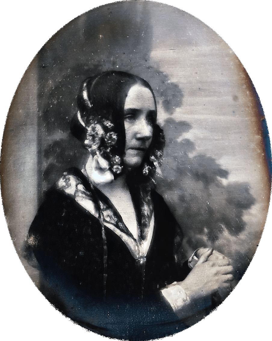 Ovale black and white three-quarter portrait of a woman holding her hands.