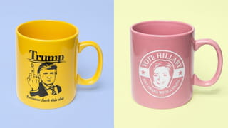 Two cups, one yellow with an cartoon of Trump giving the finger with the text 'because fuck this shit', one pink one with 'Vote Hillary, like Obama with a vagina'