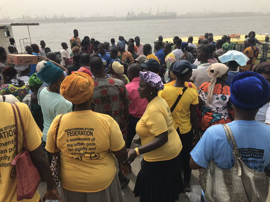 Several members of the Nigerian Slum/Information Settlement Federation who have been evicted from their homes in Tarkwa Bay stand on the CMS jetty.
