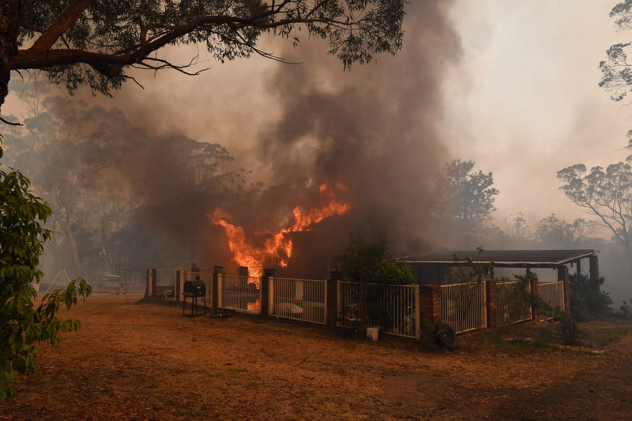 A house burns on a property in Buxton, New South Wales, 19 December 2019. Temperatures above 40 degrees Celsius and strong winds are fanning a a number of fires around Sydney.