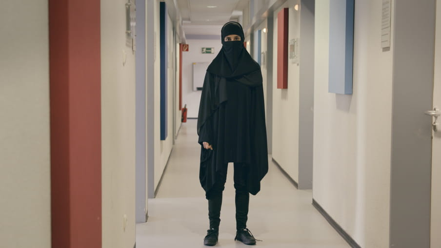 Maryam wearing a burka in order to be allowed into