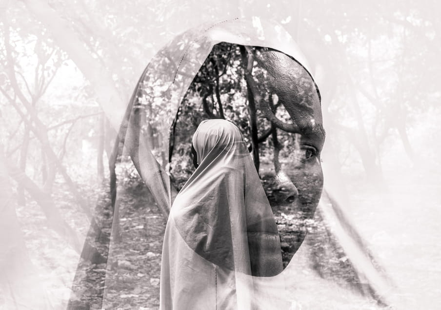 Two superimposed black and white photographs of a face in a white headscarf tied around the face looking to the right; behind this image is a picture of a figure shrouded in a white long abaya standing in what seems to be a forest