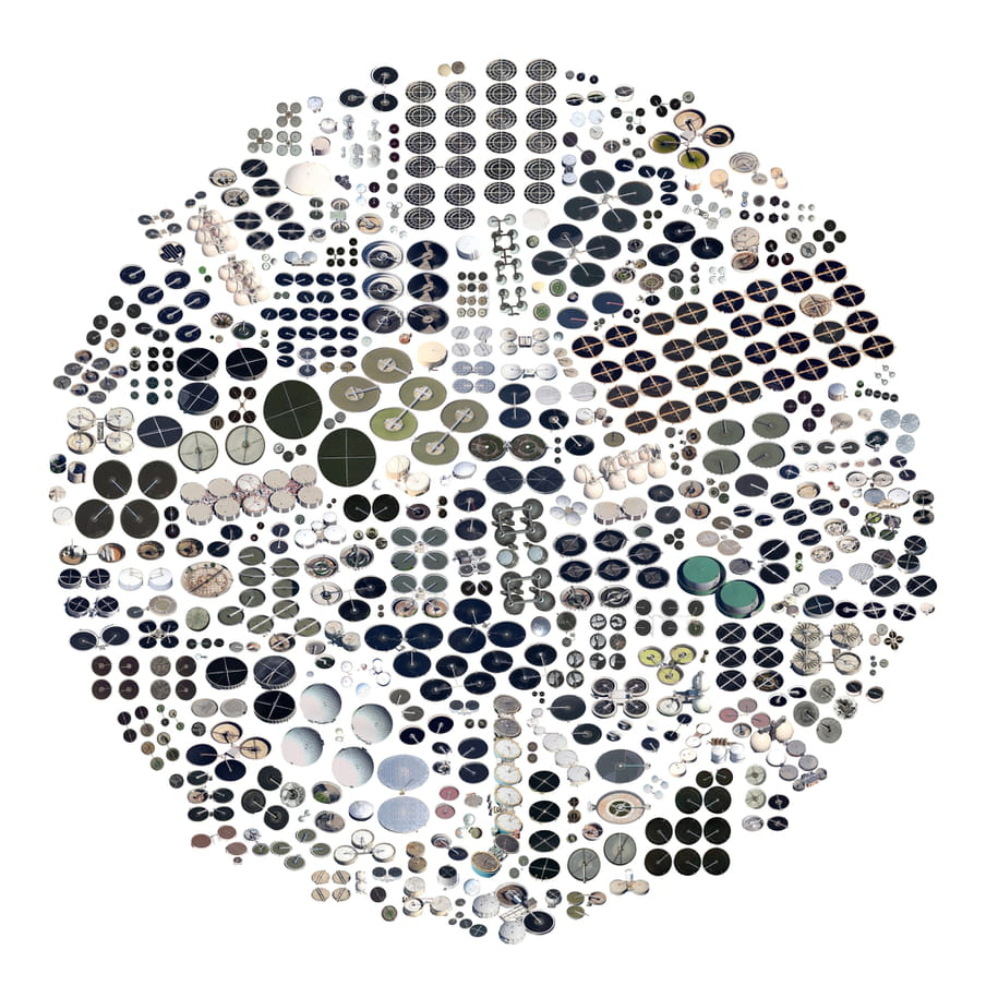 Circle shaped image, on a white background, composed of various tiny circular shapes in white, grey, black and green shades.