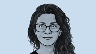 Illustrated avatar of a woman with long dark hair and glasses, Nabeelah Shabbir.