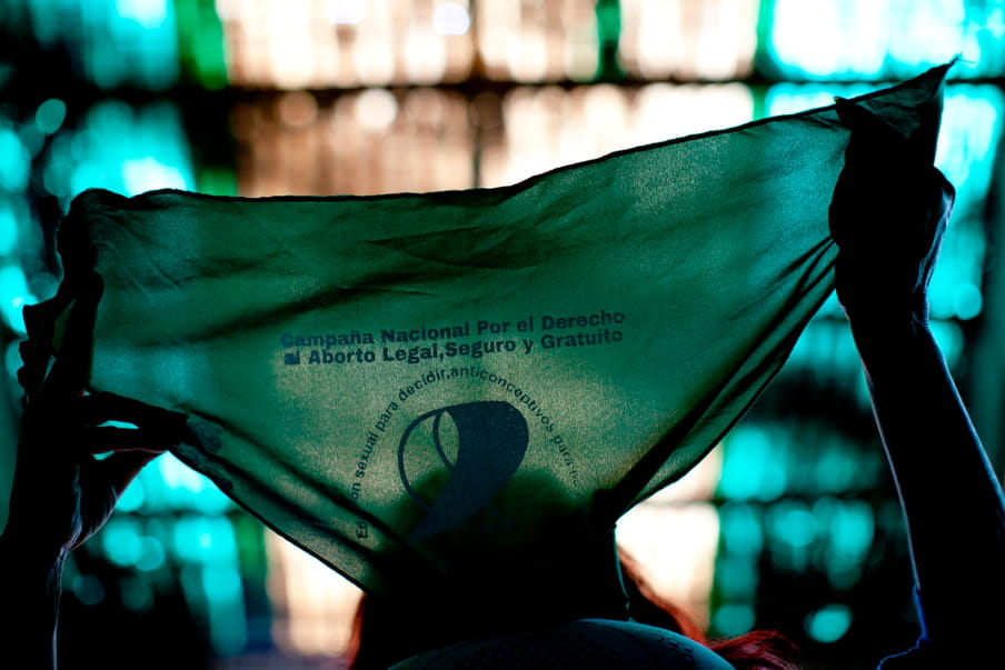 Photo of a person holding a green bandana up with backlight