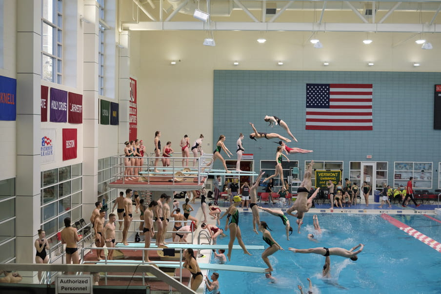 Photo-montage of heavily crowded female diving competition.