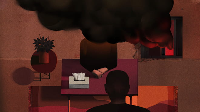 Illustration, in deep reds and oranges, of a therapist's office with black smoke coming in through the window, blocking the head of the therapist. The figure sits at a purple table, with the back of a head in silhouette facing them. There is an orange rug under the table, which in this illustration looks like it is facing forward