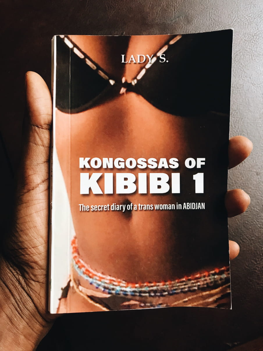 Photo of a hand holding a book with the title Kongossas of Kibibi 1