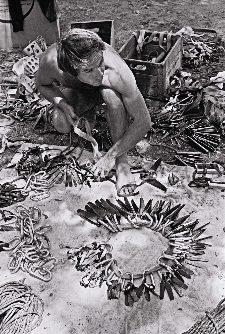 Black and white photo of man working on wooden tools