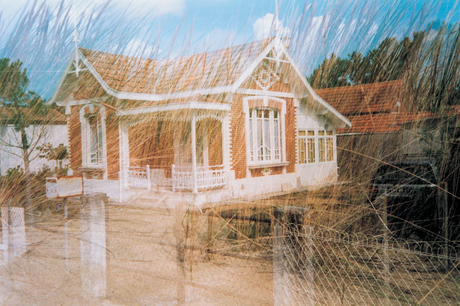 Double exposure photograph - of a house and a field of grass, overlapping.