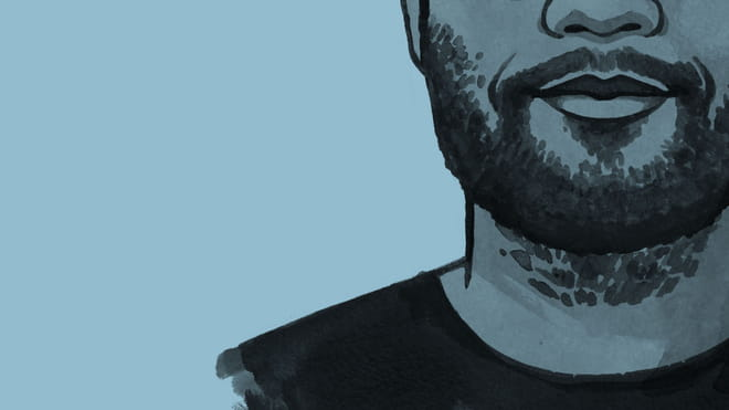 A cross section of an illustration of the author's face, with beard and moustache and a smile, against a blue background.