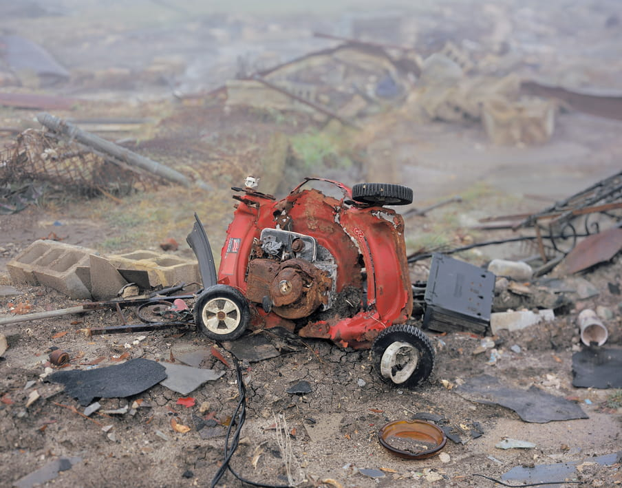 Photo of a lawnmower, destroyed and in pieces