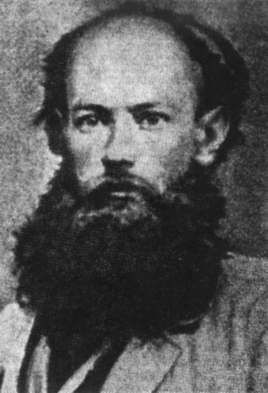 Black and white portrait of a man with a beard.