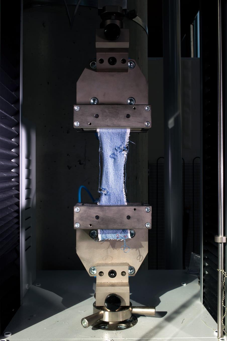 Photo of a machine pulling on fabric