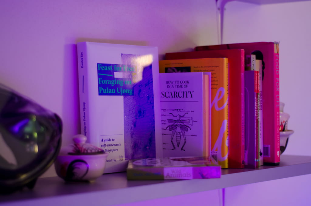 Photo of bookshelf showing books scarcity, cooking and foraging