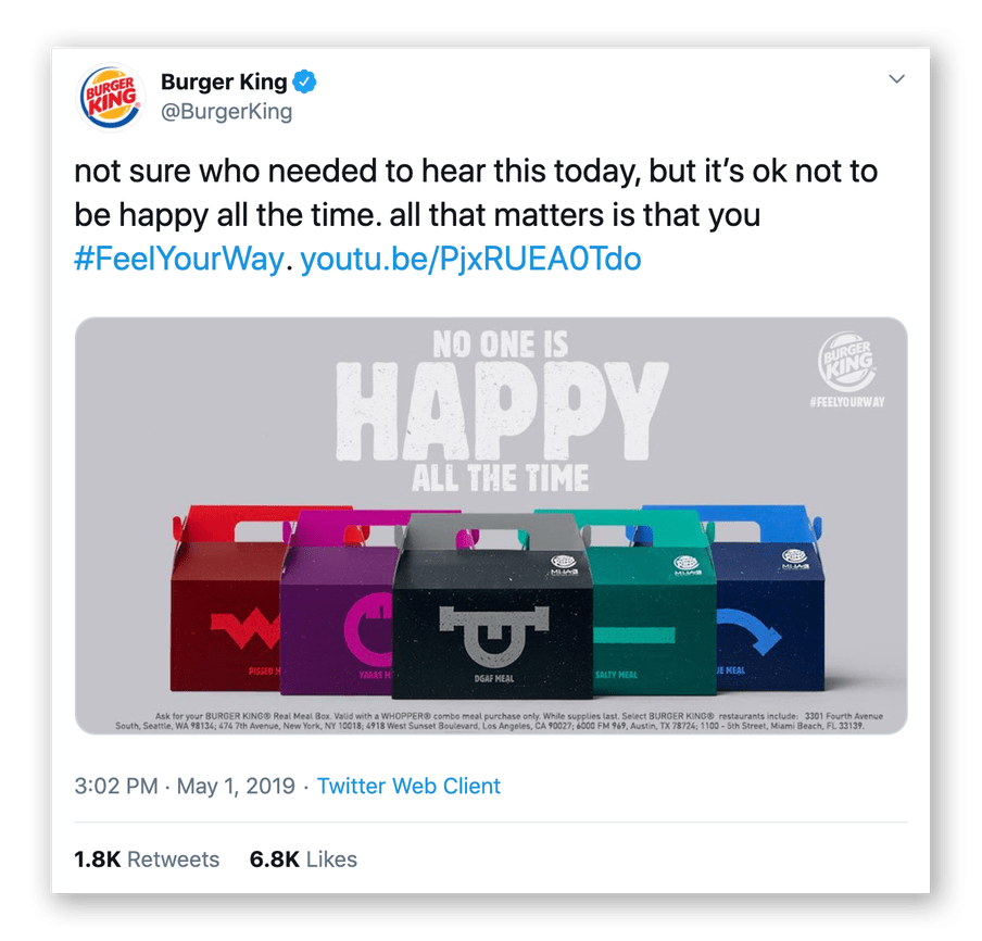 """Screenshot of a tweet by Burger King showing a commercial stating """"not sure who needed to hear this today, but it's ok not to be happy all the time. All that matters is that you #FeelYourWay."""" It also shows an image with their products and the text """"No one is happy all the time""""."""