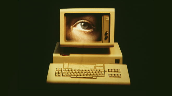 Picture of a computer monitor showing a close up of a human eye.