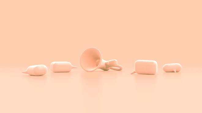 3D animation of a loudspeaker - made of either white foam or concrete to the eye - lying on the floor, with two 3D speech bubbles both lying and standing on the floor on either side of it. The filter of the image is a light orange, the objects a faded white