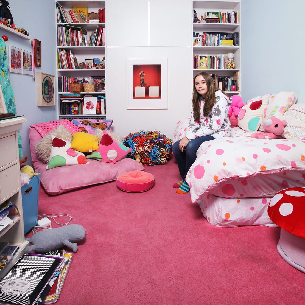 Photo of the same girl, a bit older, surrounded by some pink stuff