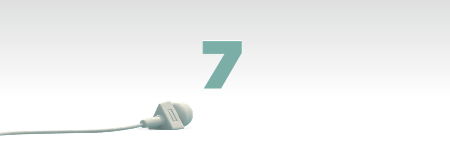 Illustration of the number seven in green with a mic laying in front of it