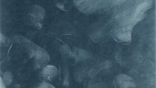 Thin sharp white lines and patterns of different blues, as if the dark background has been smudged with fingerprints